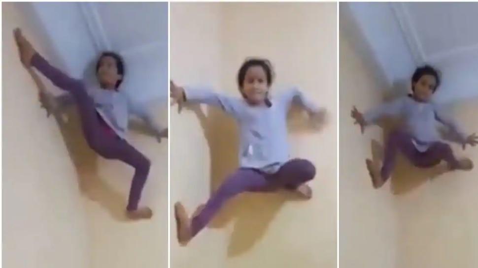 चिमुकली बनली Spider girl, भिंतीवर चढत केला खतरनाक स्टंट