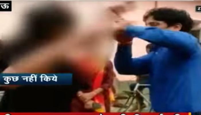 व्हिडिओः दिल फेक मजनुला दिला तरूणीने चोप