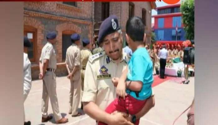 POLICE MAN CARRYING KILLED COP_S 4-OLD SON BREAKS DOWN DURING HOMAGE