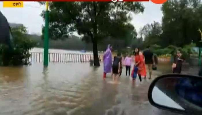 Thane As Upvan Lake Overflow People People And Small Childrens Playing In Water Ground Report