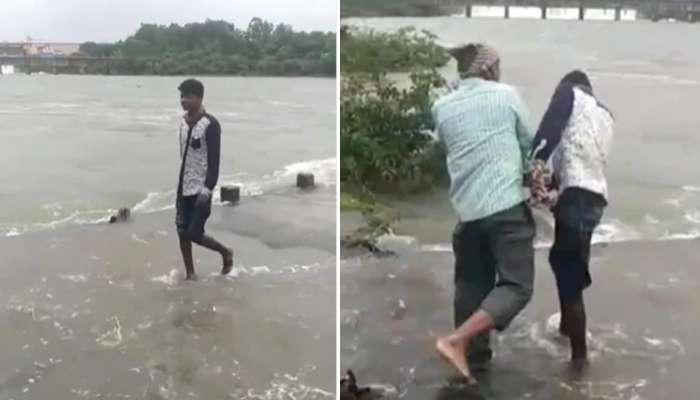 नदीचा जोरदार प्रवाह पार करणं तरूणाला पडलं भारी, वडिल-भावाकडून जोरदार कानशिलात : VIDEO